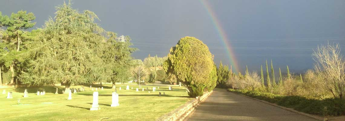 Picture of Grave Markers and Rainbow at Summit Cemetery District.